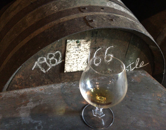 Armagnac-Domaine-de-Jouanda-barrels-and-glass
