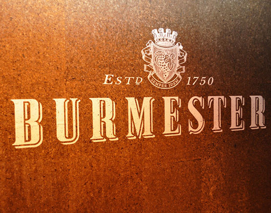 logo burmester on wall
